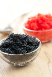 Red and black caviar in bowl Royalty Free Stock Photo