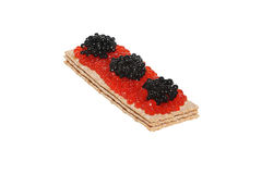 Red and black caviar on crispbread Royalty Free Stock Photography