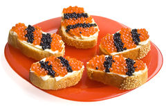 Red And Black Caviar Snacks As St. George Ribbons Royalty Free Stock Image