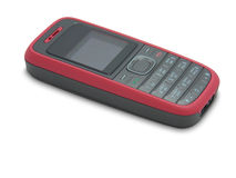 A red and black cell phone. A red cell phone against white background stock photography