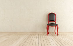 Red and black classici chair against wall Royalty Free Stock Photo