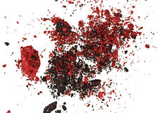 Red and black color crumbled eye shadows Royalty Free Stock Image
