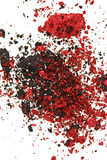 Red and black color crumbled eye shadows Stock Photos