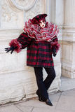 A red and black costume (2). A woman in a red and black Venice carnival costume Stock Photography