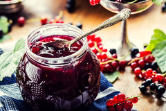 Red and black currants. red currant jam with fresh berry Stock Photo