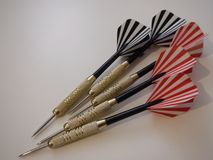 Red and black darts on a white background. Red and black darts on a simple white background Stock Photography