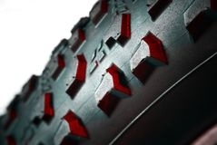 Red and black detail of MTB tire Royalty Free Stock Image