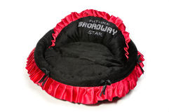 Red and black dog bed. Stock Photos