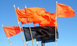 Red&Black Fishing flags. Colored fishing flags in strong wind Stock Photos