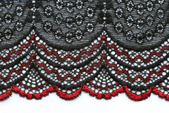 Red and black flowers lace material texture macro shot Royalty Free Stock Images