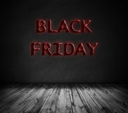 Red Black Friday on stone rock background and wooden floor Stock Image
