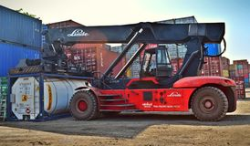 Red and Black Front-loader Beside Intermodal Containers Stock Photography