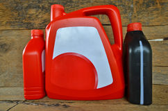 Red and black gallons of motor oil Royalty Free Stock Photos