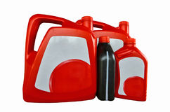 Red and black gallons with white label of motor oil Royalty Free Stock Images
