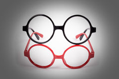 Red and black glasses with lighting Stock Image