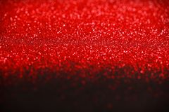 Red and Black Glitter background. Holiday, Christmas, Valentines, Beauty and Nails abstract sparkling texture Stock Photos