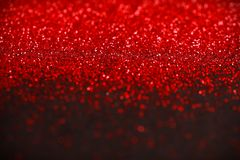 Red and Black Glitter background. Holiday, Christmas, Valentines, Beauty and Nails abstract sparkling texture Royalty Free Stock Images