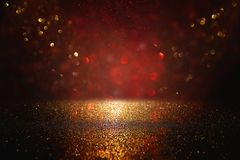 Red, black and gold glitter lights background. defocused. royalty free stock image
