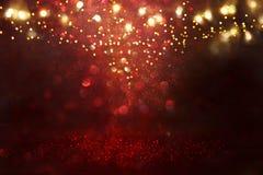 Red, black and gold glitter vintage lights background. defocused. Red, black and gold glitter vintage lights background. defocused royalty free stock photo