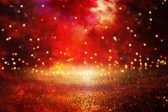 Red, black and gold glitter vintage lights background. defocused. stock images
