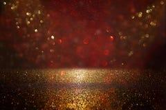 Red, black and gold glitter vintage lights background. defocused. Red, black and gold glitter vintage lights background. defocused stock photography