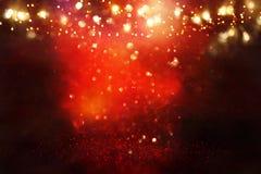 Red, black and gold glitter vintage lights background. defocused. Red, black and gold glitter vintage lights background. defocused royalty free stock image