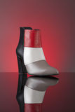 Red-black-grey ankle boot Stock Image