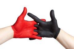 Red and black handshake Stock Image