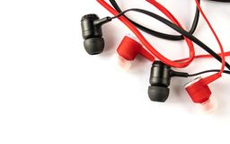 Red and black headphones with headset lie on a white background isolated royalty free stock images