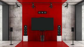 Red and black home cinema system. With sound equipment and tv against concrete wall - 3d rendering Stock Photography