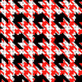 Red and black houndstooth pattern with polka dots. Stock Image