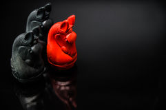 Red and Black Knight Thai chess pieces with black background and selective focus Stock Photos