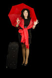 Red black lady traveling with big suitcase Stock Photos