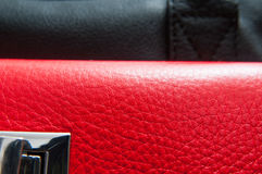 Red and black leather. Black and red leather from a fashionable bag in close up Royalty Free Stock Photos