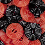 Red and Black Licorice Wheels. A background of black and red licorice wheels Stock Photos