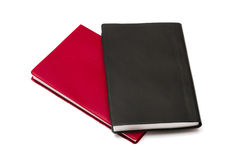 Red and black notebooks Stock Photos