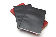 Red and black notebooks Stock Images