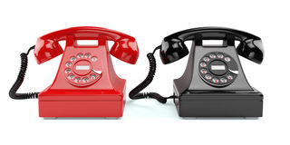 Red and black old-fashioned phones isolated Royalty Free Stock Images