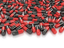 Red and black pills  white background. Stock Photo