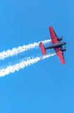 Red and black plane high in the sky. I captured this image at an Air Show in Waterloo, Iowa in August of 2014. This plane once used to haul executives from place stock photos