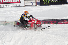 Red and Black Polaris Snowmobile during race. EAGLE RIVER, WI - MARCH 2:  Red and Black Polaris Snowmobile during a race on March 2, 2013 in Eagle River Stock Image