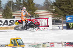Red and Black Polaris Snowmobile Racer Pointing to crowd Stock Photos
