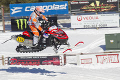 Red and Black Polaris Snowmobile Racing in Air Royalty Free Stock Photos