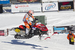 Red and Black Polaris Snowmobile Racing High in Air Royalty Free Stock Images
