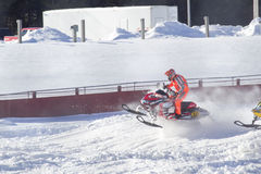 Red and Black Polaris Snowmobile Racing over jump Royalty Free Stock Photo