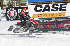 Red and Black Polaris VForce Snowmobile Racing in Air Stock Photos