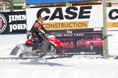 Red and Black Polaris VForce Snowmobile Racing. EAGLE RIVER, WI - MARCH 2: Landing Red and Black Polaris VForce Snowmobile Racing in Air during a race on March 2 Stock Image