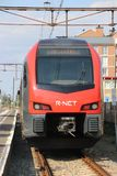 Red and black R-NET light rail train vehicle at the train station of Boskoop. Of the line between Alphen and Gouda royalty free stock photography