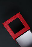 Red black rectangular ring box on dark background Stock Image