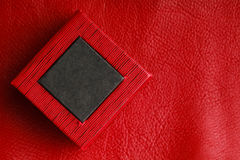 Red black rectangular ring box on leather background Stock Images